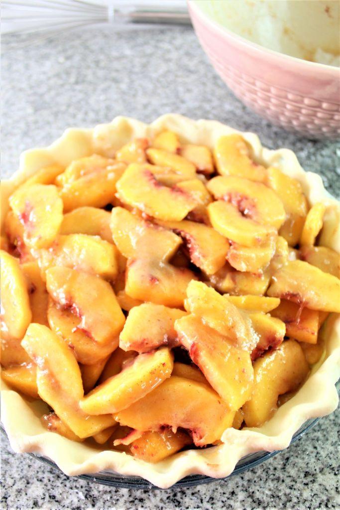 peach pie filling inside bottom crust