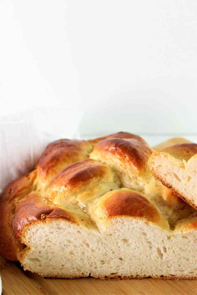side shot of cut into challah loaf