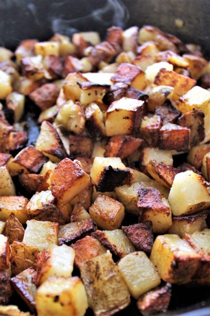 hot breakfast potatoes in cast iron skillet