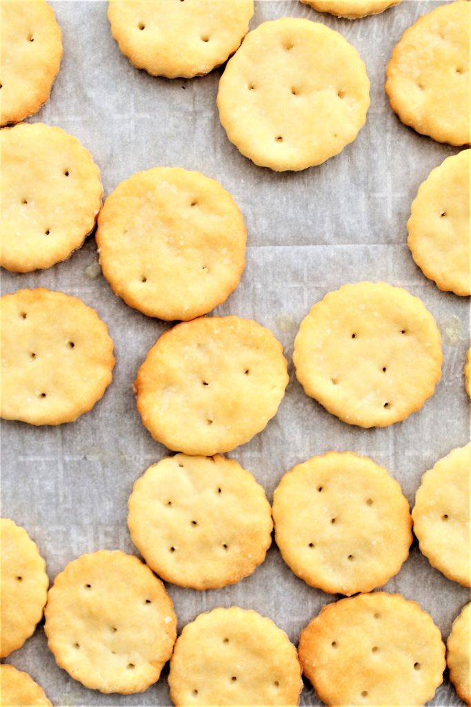overhead shot of crackers on parchment-lined baking sheet