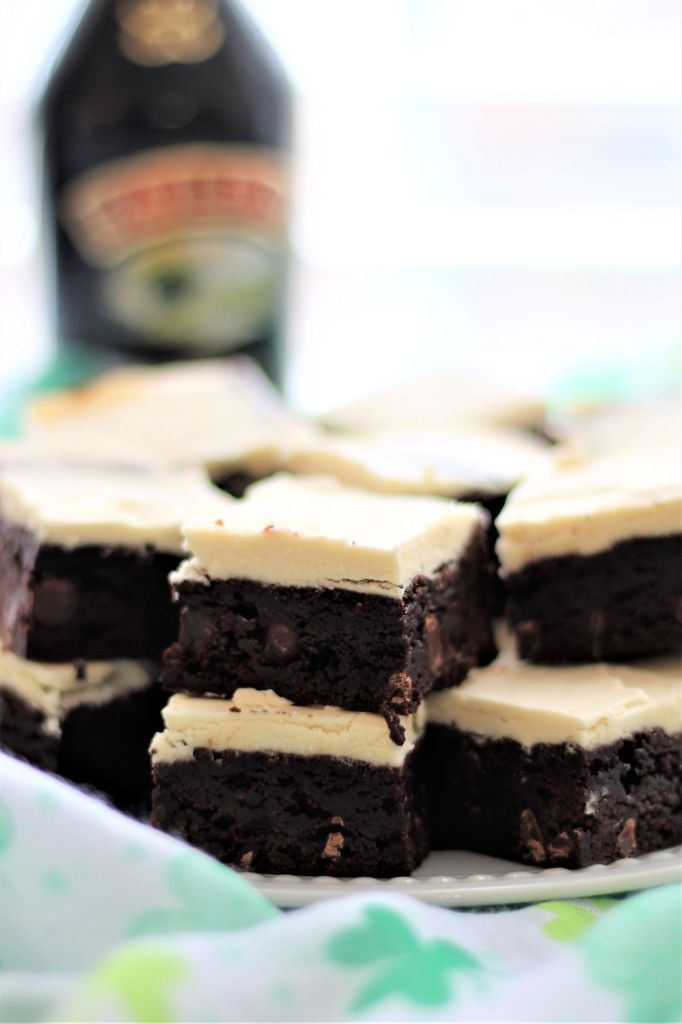 irish cream brownies on a plate with shamrock scarf around them