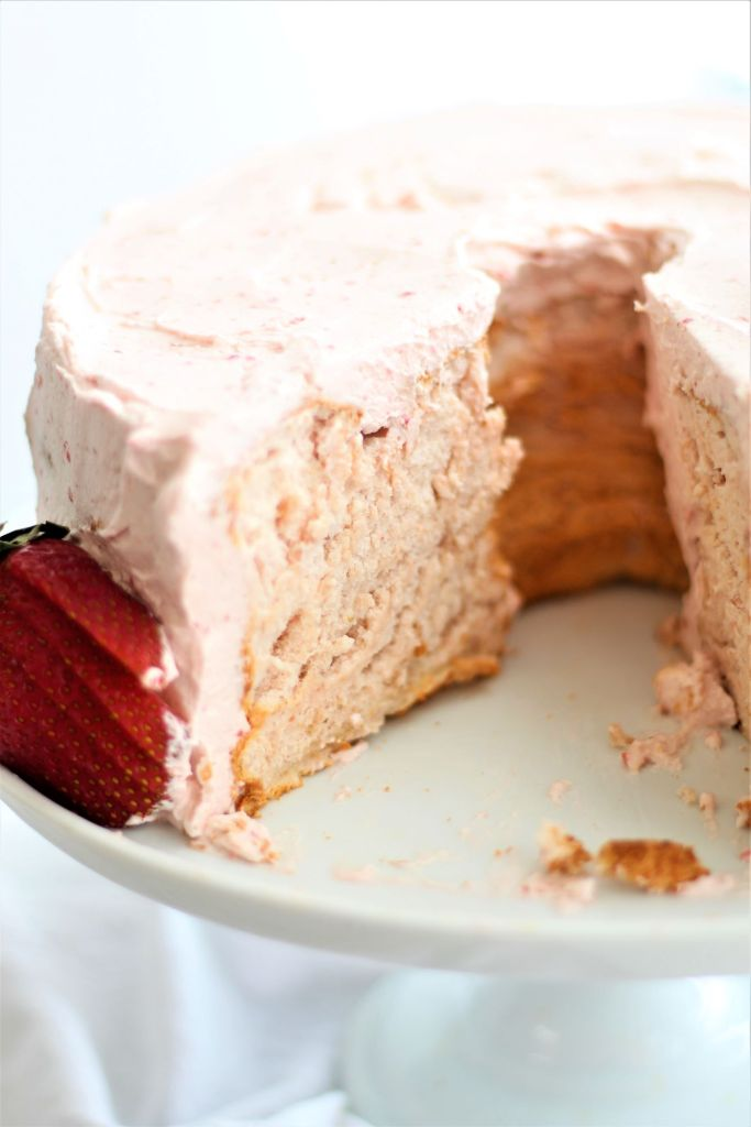 inside view of angel food cake with a couple slices taken out of it