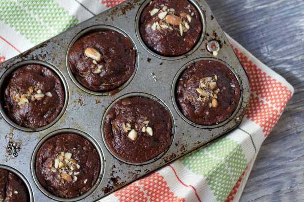 Chocolate Zucchini Muffins in muffin tins, baked