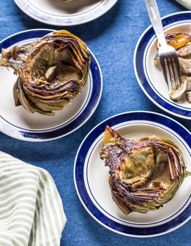 Lemon Roasted Artichokes on plates