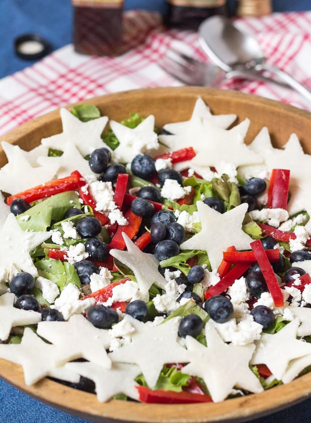 Red, White, and Blueberry Salad in wooden bowl