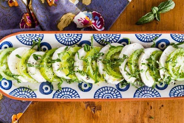 Green Zebra Tomato Caprese Salad arranged