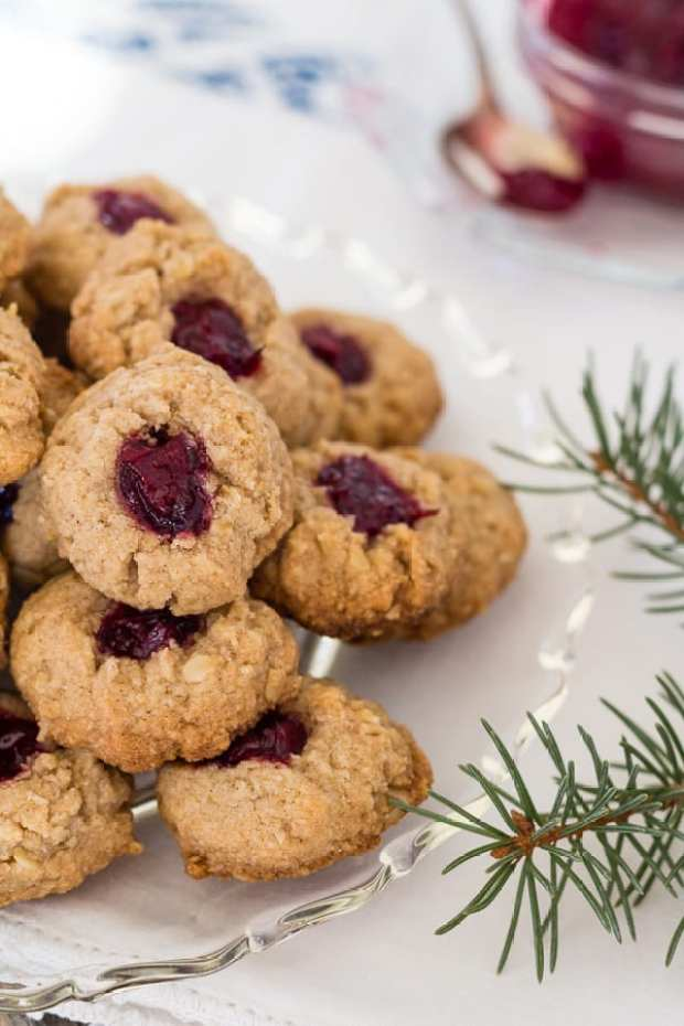 Almond Cranberry Thumbprint Cookies with cookies on left