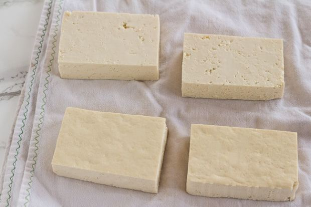 draining tofu slabs for Thai Peanut Noodles with Golden Tofu