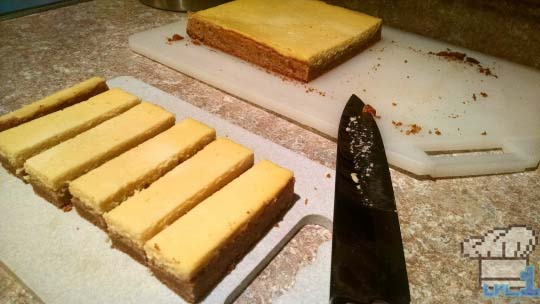 The Peanut Cheese Bars have been sliced and are waiting to be coated in chocolate before eating.
