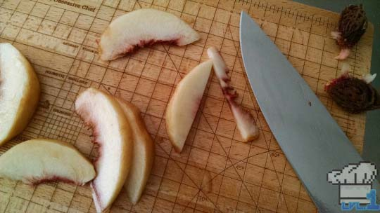 Sliced peaches ready to be assembled in the tart dough before baking.