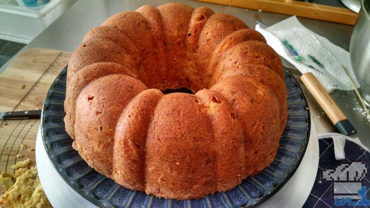 The finished bundt cake removed from the pan and placed on a plate.