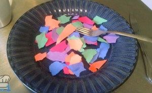 Torn up pieces of colorful construction paper on a plate as a joke Temflakes recipe from the Undertale game series.