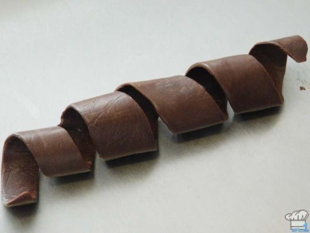 Completed chocolate plastic spiral garnish for the top of the cannon car from the Legend of Zelda Spirit Tracks game series.