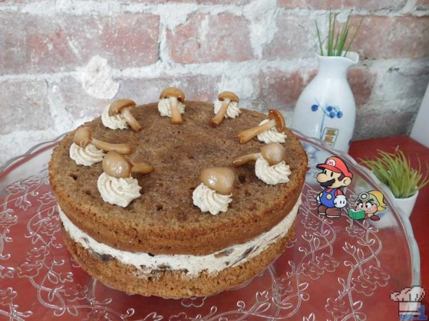 Finished and frosted two layer mushroom Shroom Cake from the Paper Mario Thousand Year Door game series.