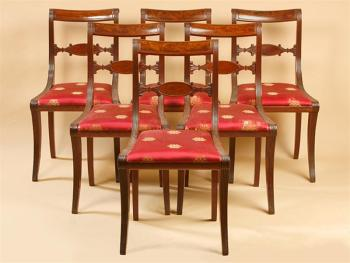 SUITE OF SIX SCROLL-BACK CHAIRS WITH CARVED OVAL VENEERED SPLAT
