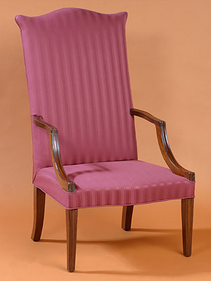 FEDERAL HEPPLEWHITE LOLLING CHAIR WITH A SERPENTINE TOP RAIL AND SEAT