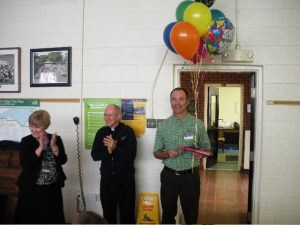 Mr. Jack Viorel with balloon bouquet announcing his selection as Lewis Award Recipient