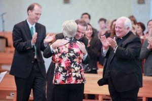 Mrs. McGrady receives congratulations from Bishop Burbidge