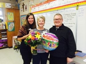 Mrs. Toni Justice, 2013-2014 Lewis Award Recipient, with Mrs. Peggy Lane, Principal of St. Egbert School, and Fr. Tom Davis, Pastor of St. Egbert Catholic Church, Morehead City.