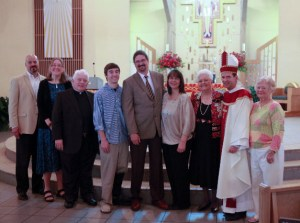 Joe Hughes and family with Msgr. Lewis, Bishop Burbidge and Anne Stahel