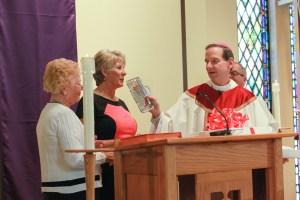 Bishop Burbidge and Mrs. Anne Stahel presenting the 2013-2014 Lewis Award to Mrs. Toni Justice