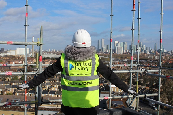 A United Living employee on the roof