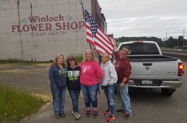 Small Acts of Kindness volunteers install flags in Winlock on Flag Day. This group began the project at 5:00 a.m. Photo courtesy: Small Acts of Kindness.