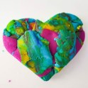 "This purposely out of focus playdough heart was created for Kiyomi by her son Leighlan. ""I made a heart because you are my heart,"" he said when he gave it to her. Kiyomi will use the photograph for the cover art of her book ""Heart work."" Photo courtesy: Happy Beautiful Wealthy Photography."