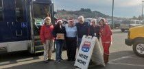 Staff from Twin Transit and KELA KMNT Radio enjoy the sunshine while spreading holiday cheer to local families. Photo credit: Krysta Carper.