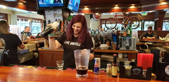 "Kayla enjoys O'Blarney's even on her days off. After antiquing, she stops in for the scrumptious food or for trivia nights. ""l love the environment and schedule and everything about it,"" she says. ""It really just fits in my life perfect."" Photo credit: Krysta Carper."