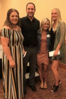 Visiting Nurses Foundation Scholarship recipients Taylor Barker, with presenter Trevor Elliot Insurance Agent with HUB International Chehalis and Visiting Nurses board member, recipients Josie Rosbach and Mackenzie Moore. Photo credit: Centralia Chehalis Chamber of Commerce.