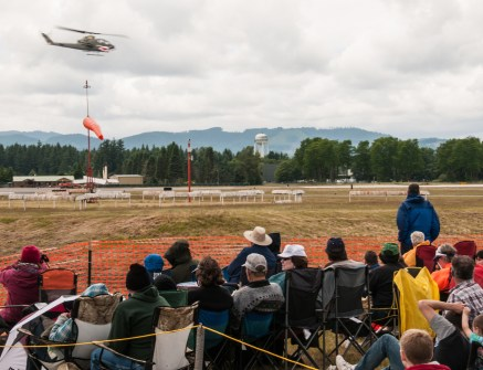 This is a photo of last year's attendees enjoying a performance by the Bell AH-1 Cobra helicopter. Photo courtesy: Frank Townsend of the Olympia Camera Club.