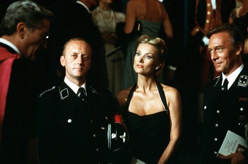 Le commandant SS et son épouse, avec le cardinal : c'est encore l'époque des amabilités.