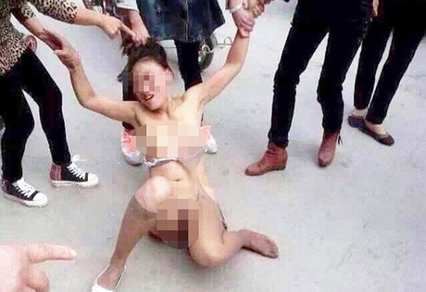 "Pic shows: Lin Yao Li who was accused of sleeping with another woman's husband was stripped naked and beaten.nnA woman accused of sleeping with another woman's husband was stripped naked and beaten senseless in broad daylight as passers-by watched on.nnIt is only the latest in a number of similar incidents in which it seems there is placid acceptance in Chinese society of such humiliation, as long as the victim is seen as deserving in having caused a man to cheat on his partner.nnAccused Lin Yao Li, 38, was ambushed by four women as she walked home from the shops in the city of Puyang in Eastern China¿s Henan Province.nnPunching and kicking her to the ground while she writhed in agony, her attackers then ripped her clothes off and continued the beating, pulling her hair and kicking her in the breasts and groin.nnThe sickening attack they said was carried out by the scorned wife of the man Lin is accused of sleeping with, and her three friends, and it was watched by passersby who didn¿t think it was their duty to help the defenceless woman.nnLocal man Jun Feng, 30, who helped the woman after spotting her lying on the ground after the women left told local TV: ""This type of thing is becoming quite normal.nn""Angry wives and girlfriends get their revenge on their cheating men by attacking the other woman.nn""People don¿t tend to get involved because they see it as being an argument of the heart,"" he said.nnThe woman was later taken to hospital where she was being treated for cuts, severe bruising and shock after begging someone to call an ambulance.nnLast month a similar attack happened in Jinan city, in Eastern China's Shandong Province, when three women wearing stilettos stripped and stamped on a women they accused of cheating.nnAnother attack was caught on camera in July in China's south-eastern city of Yulin, Guangxi province.nnA police spokesman declined to comment, saying they had not received any complaint from any of those involved.nn(ends)n"