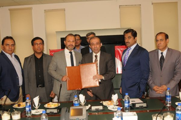 Chairman TEVTA Irfan Qaiser Sheikh and Country Head Oracle Pakistan Afghanistan Syed Azam Abidi exchanging agreements.