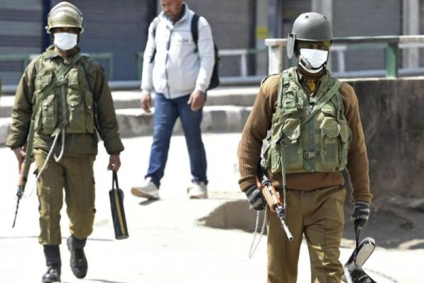Kashmiris face indian forces, coronavirus