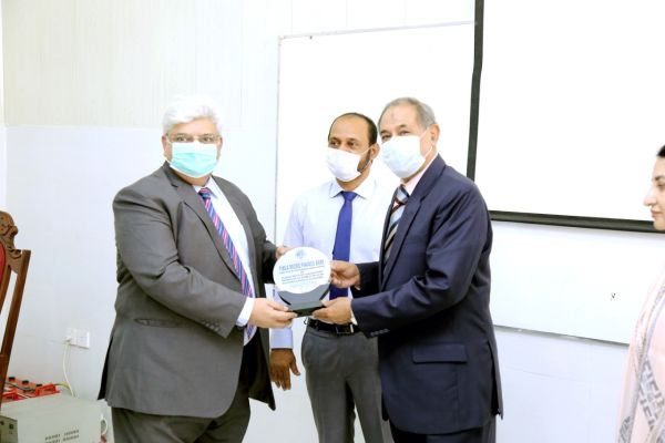 FINCA donates to IPH - Mubashar Bashir, CFO, FINCA Pakistan, receiving appreciation shield from The Chairman Board of Management, Institute of Public Health, Lt. Gen. (Rtd.) Khalid Maqbool