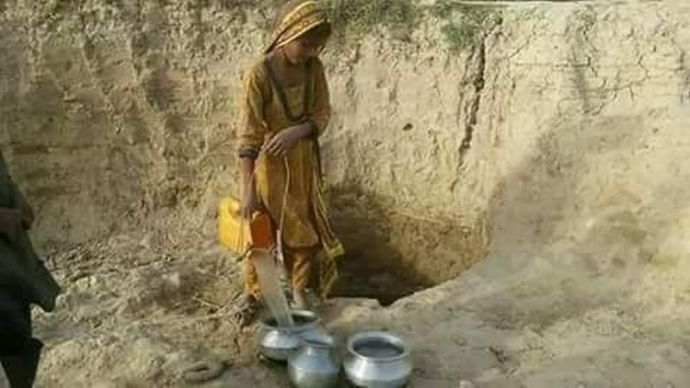 Woman fetch water from well
