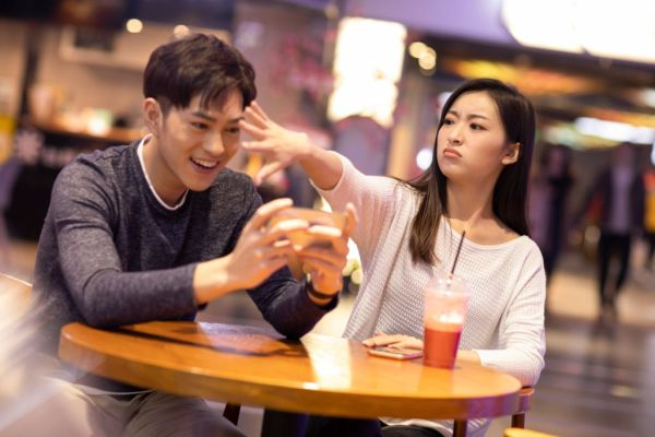 Young Chinese couple having a bad date