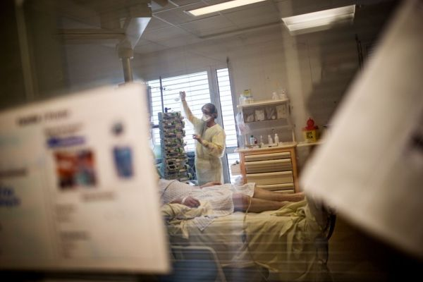 nurse with coronavirus infected patient