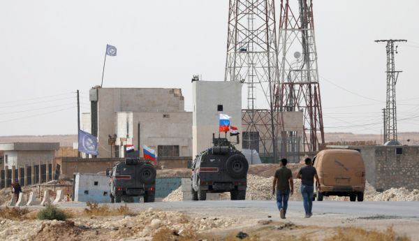Russian and Syrian flags on military vehicles near Manbij, Syria, on Tuesday.