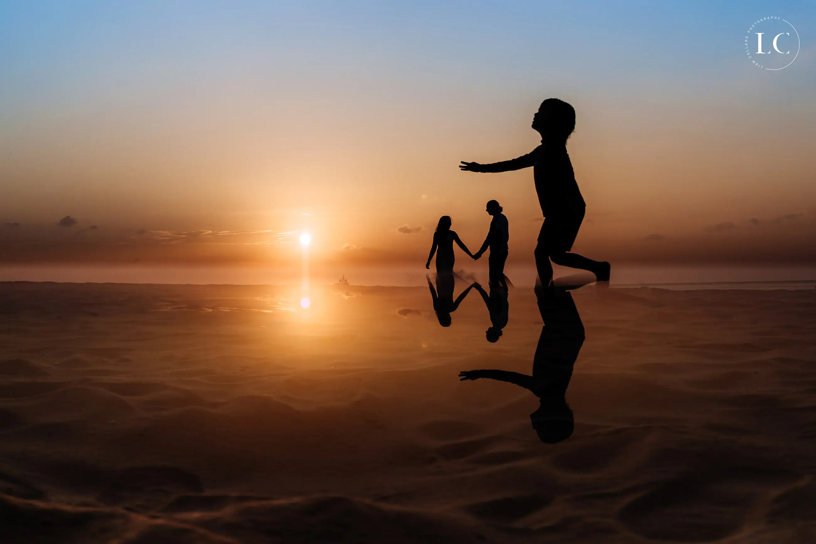Silhouette of children playing at sunset