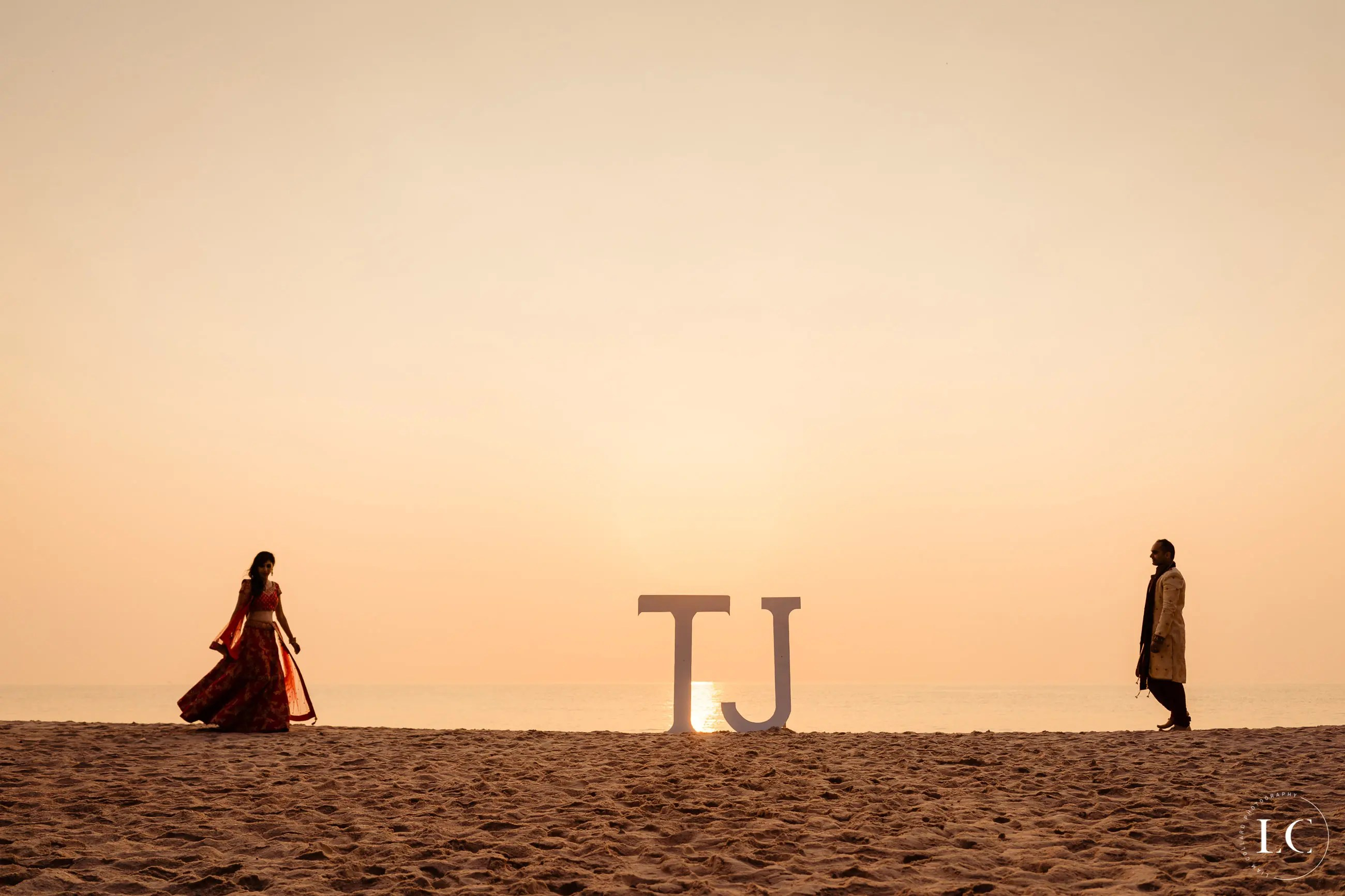 Far angle shot of bride and groom's initials at sunset