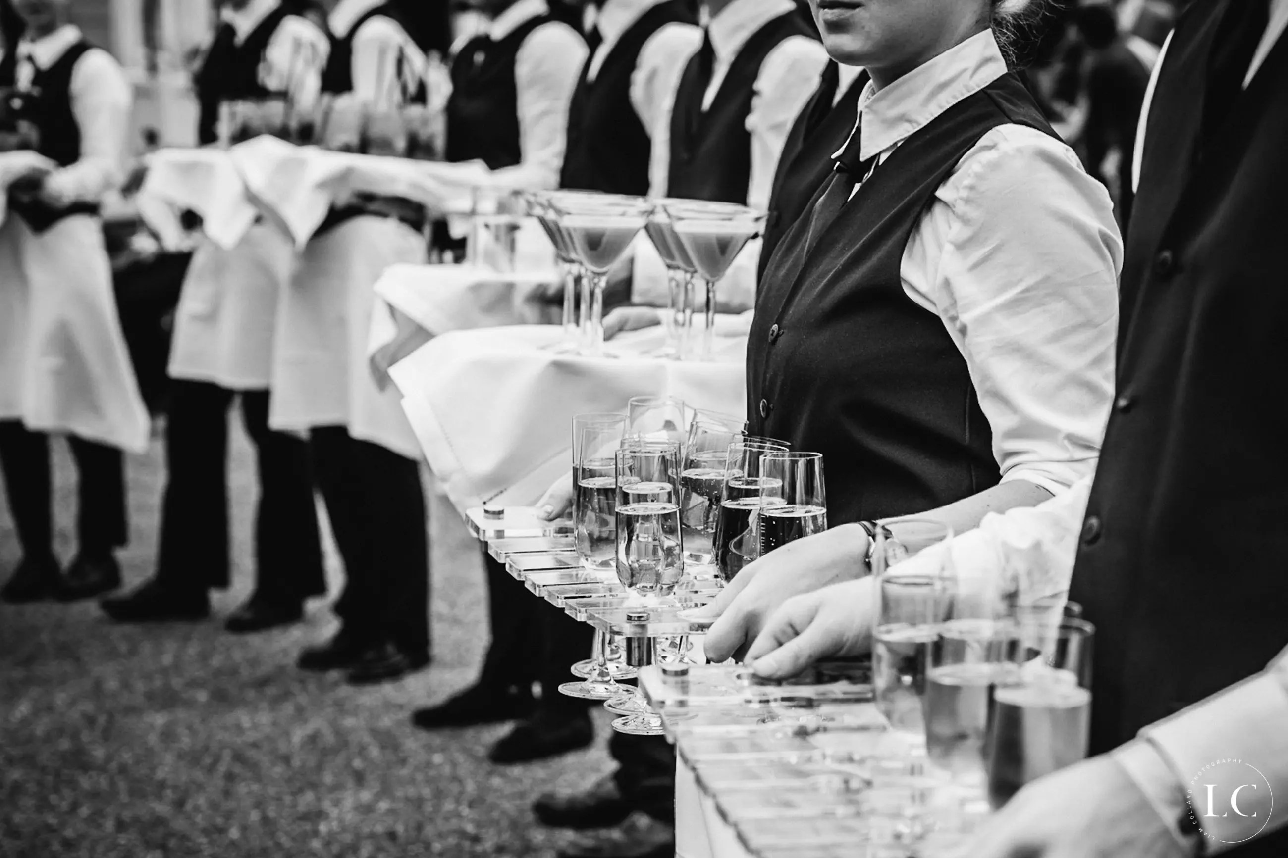Staff with champagne on wedding day