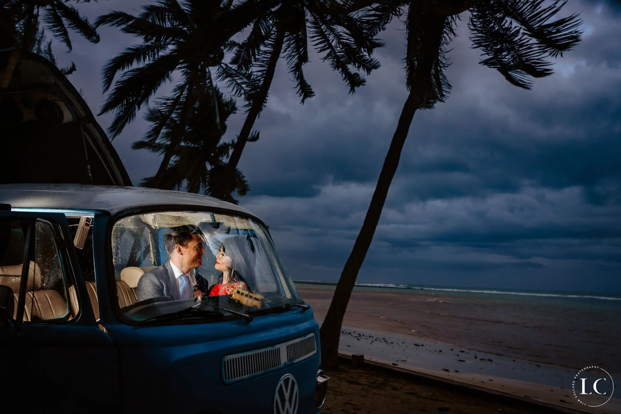 couple in car beside the beach