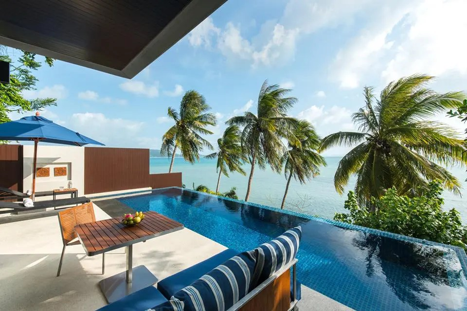 View of deck infinity pool and ocean at Conrad Koh Samui