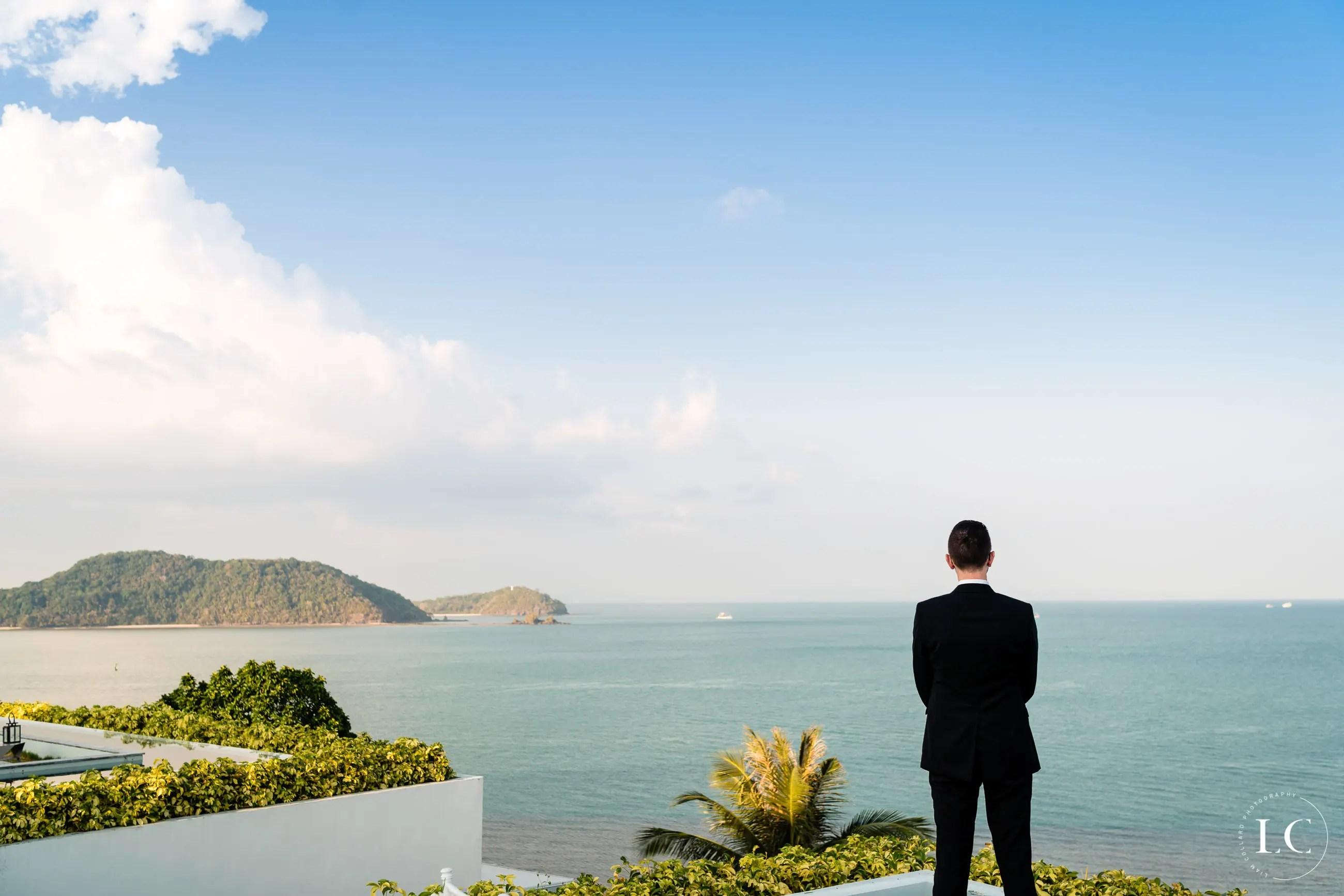 Groom looking at the ocean