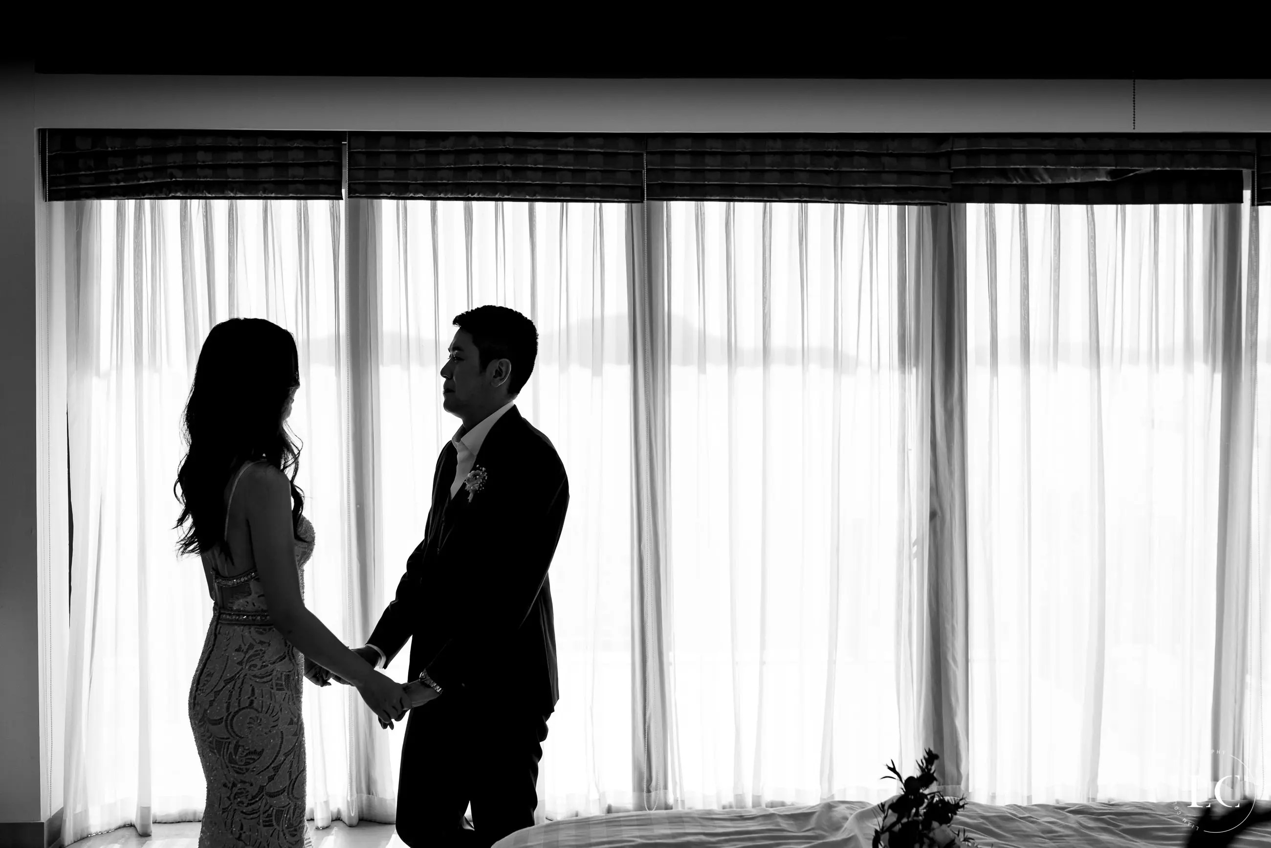 bride and groom holding hands alone