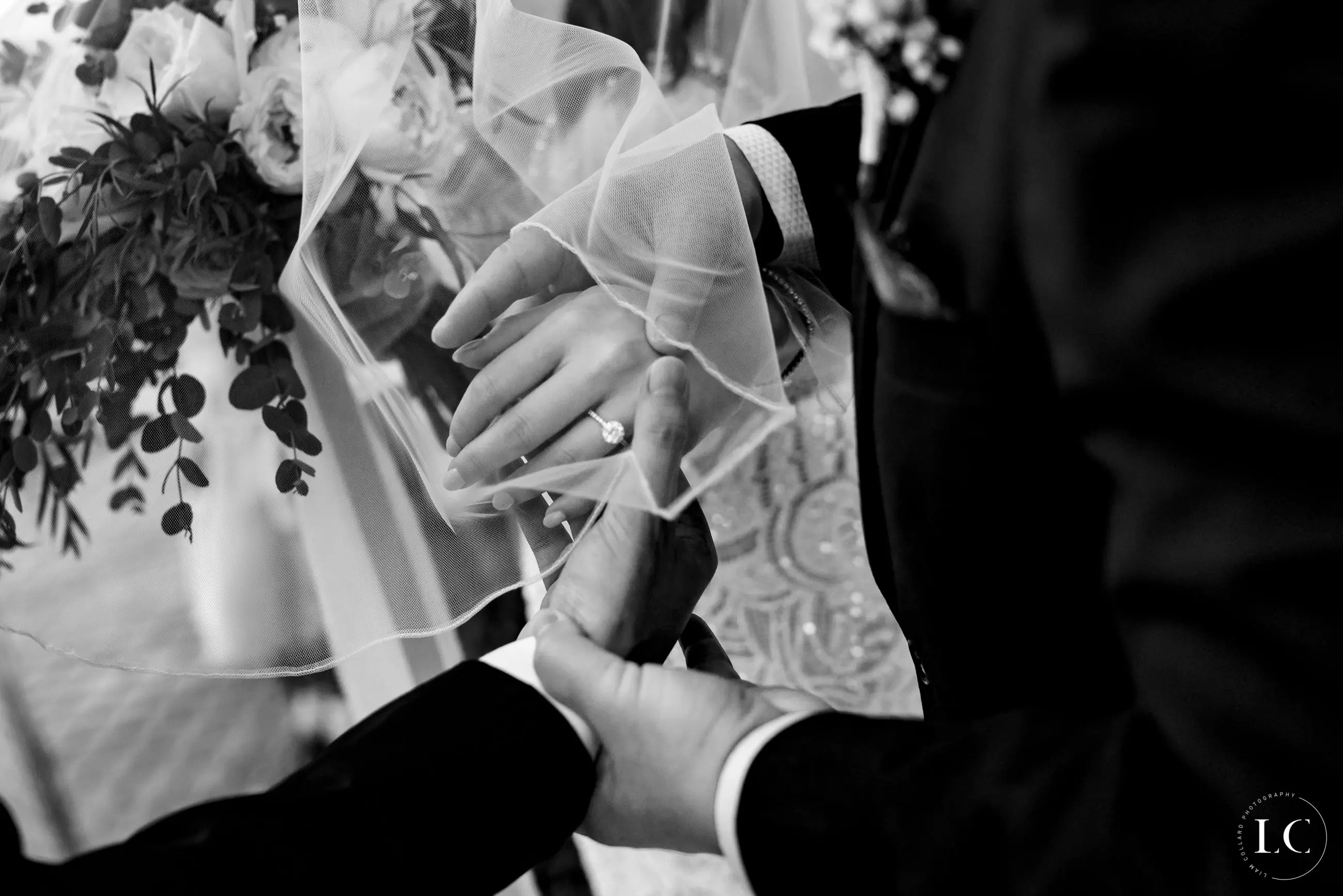 Close up of bride and groom's hands