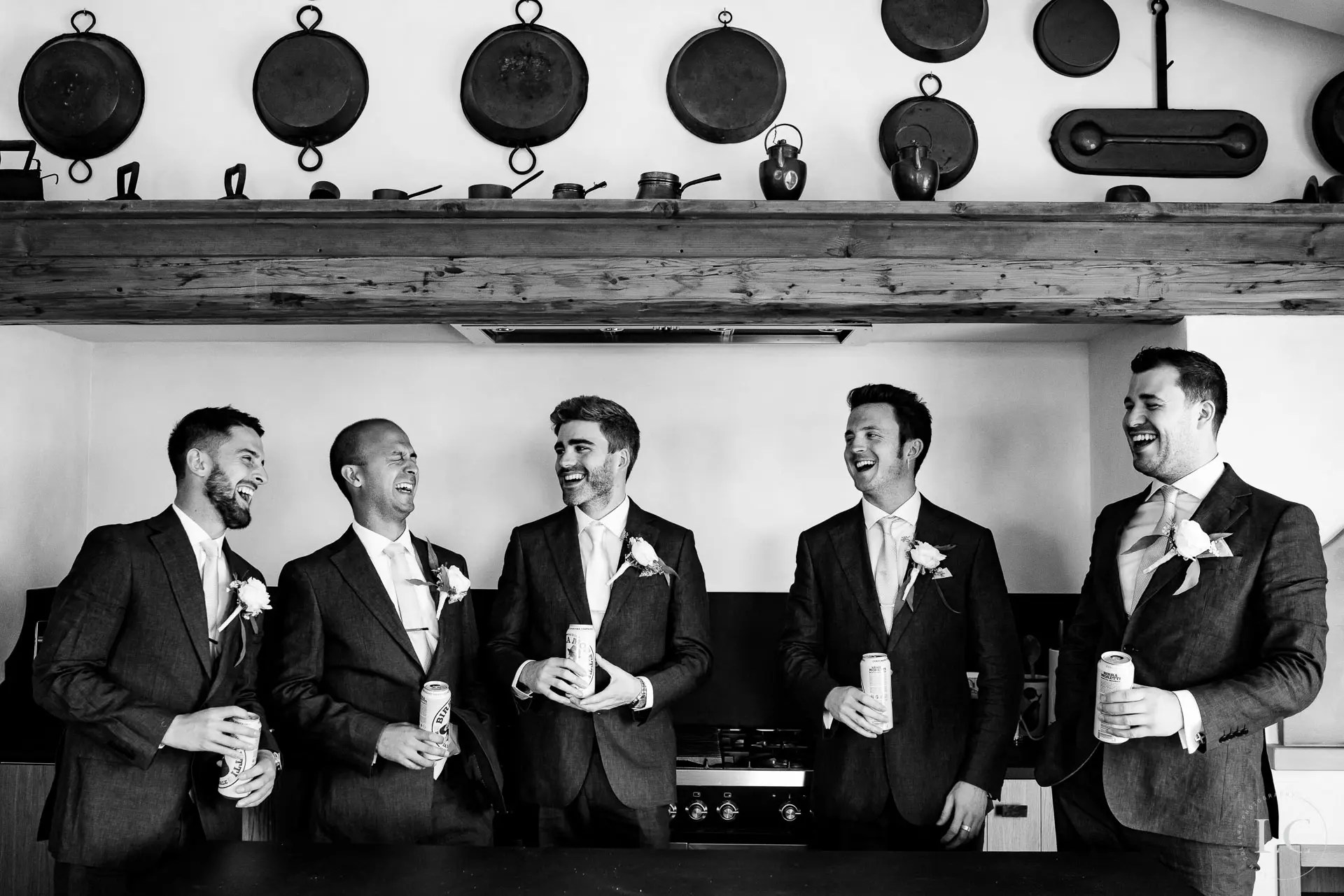 Groom and groomsmen chatting